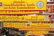 14 OCTOBER 2012 - BANGKOK, THAILAND:   Yellow banners over Yaowarat Road in Bangkok's Chinatown announce the annual Vegetarian Festival. The Vegetarian Festival is celebrated throughout Thailand. It is the Thai version of the The Nine Emperor Gods Festival, a nine-day Taoist celebration beginning on the eve of 9th lunar month of the Chinese calendar. During a period of nine days, those who are participating in the festival dress all in white and abstain from eating meat, poultry, seafood, and dairy products. Vendors and proprietors of restaurants indicate that vegetarian food is for sale at their establishments by putting a yellow flag out with Thai characters for meatless written on it in red.     PHOTO BY JACK KURTZ