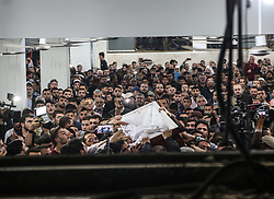 April 26, 2018 - Jabaliya, Gaza strip, Gaza - Palestinian mourners carry a coffin containing the body of Palestinian scientist Fadi al-Batsh, assassinated in Malaysia, after his body was returned to his native Gaza Strip on April 26, 2018 for his funeral in the city of Jabalia, in the north of the Palestinian enclave. Batsh, a member of the Islamist Hamas movement, was shot dead in a hail of bullets by motorbike-riding attackers as he walked to a Kuala Lumpur mosque for dawn prayers on April 21, 2018 (Credit Image: © Nidal Alwaheidi/Pacific Press via ZUMA Wire)