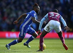 Aston Villa's Albert Adomah (right) and Birmingham City's Jacques Maghoma battle for the ball