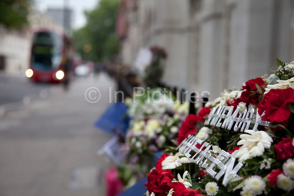 5th anniversary of the July 7th 2005 bombings. Flowers are laid in memory of the victims of the 7/7 bombings in London. Here the memorial is on Tavistock Square, where the bus bombing took place. A bus passes near to where the bomb exploded in this terrorist attack.