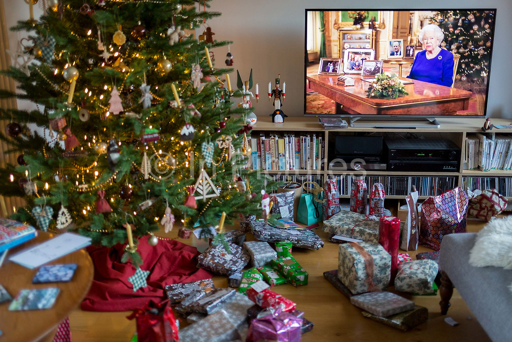 Christmas presents remain unopened beneath a Christmas tree during the Queens speech to the nation on Christmas Day, a tradition started in 1932 and which she first broadcast on television in 1957, on 25th December 2019, in Bristol, England.