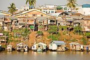 17 MARCH 2006 - KAMPONG CHHNANG, KAMPONG CHHNANG, CAMBODIA: Buildings line the riverbank of the Tonle Sap River in Kampong Chhnang in central Cambodia. PHOTO BY JACK KURTZ