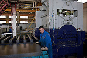 Samara, Russia, 25/02/2005..The Samara Electroschit {Electroshield] plant, one of Russia's leading electrical engineering companies. Production line staff using old East German equipment.