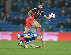 Cardiff City's Alex Revell tackles Bournemouth's Steve Cook - Photo mandatory by-line: Alex James/JMP - Mobile: 07966 386802 - 17/03/2015 - SPORT - Football - Cardiff - Cardiff City Stadium - Cardiff City v AFC Bournemouth - Sky Bet Championship