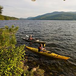 Kayakers on Lake Sunapee at Mount Sunapee State Park in Newbury, New Hampshire.