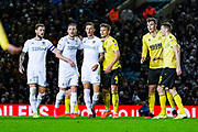 Leeds United defender Ben White (5), Leeds United defender Luke Ayling (2), Leeds United defender Liam Cooper (6) and Millwall defender Shaun Hutchinson (4) during the EFL Sky Bet Championship match between Leeds United and Millwall at Elland Road, Leeds, England on 28 January 2020.