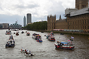Flotilla of fishing vessels on the River Thames arrive outside the Houses of Parliament to make the case for Brexit in the EU Referendum on June 15th in London, United Kingdom. The flotilla was organised by Scottish skippers as part of the Fishing for Leave campaign which is against European regulation of the fishing industry, and the CFP (Common Fisheries Policy). Between 30 and 35 trawlers travelled up the Thames, through Tower Bridge and moored in the Pool of London. (photo by Mike Kemp/In Pictures via Getty Images)
