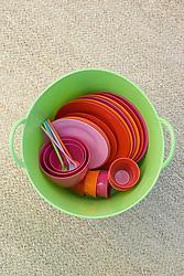 Green tub trug full of picnic set