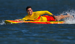 A lifeguard on a surf board during the Women's Triathlon Final at the Southport Broadwater Parklands during day one of the 2018 Commonwealth Games in the Gold Coast, Australia.