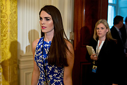 "Hope Hicks, White House director of strategic communications, arrives to a swearing in ceremony of White House senior staff in the East Room of the White House in Washington, D.C., U.S., on Sunday, Jan. 22, 2017. Trump today mocked protesters who gathered for large demonstrations across the U.S. and the world on Saturday to signal discontent with his leadership, but later offered a more conciliatory tone, saying he recognized such marches as a ""hallmark of our democracy."" Photographer: Andrew Harrer/Bloomberg"