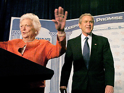Former first lady  Barbara Bush calls for quiet as the crowd cheers President George Bush during her introduction of her son at a stop at the Lake Nona YMCA Family Center in Orlando, Florida on March 18, 2005. Bush talked about his Social Security plan. Photo by Joe Burbank/Orlando Sentinel/KRT/ABACA  | 75137_02 Orlando