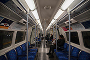 Visibly quiet on a Jubilee line tube at Canary Wharf Underground station on 19th March 2020 in London, United Kingdom. More people are working from home and Tranport for London are running a reduced tube and bus service in London in an effort to delay the spread of the  coronavirus.
