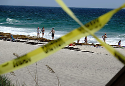 September 8, 2017 -  Lake Worth, Florida, U.S. - Caution tape blocks beach access at Lake Worth beach Friday in anticipation of the arrival of Hurricane Irma. The entrance to the Lake Worth Casino and Beach Complex was closed to vehicle traffic in anticipation of the arrival of Hurricane Irma, but there were a number of people walking along the beach and swimming. (Credit Image: © Bruce R. Bennett/The Palm Beach Post via ZUMA Wire)