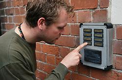 Man using door intercom,