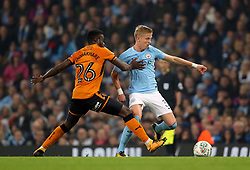 Manchester City's Oleksandr Zinchenko (right) and Wolverhampton Wanderers' Bright Enobakhare battle for the ball