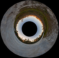 Little Planet view of Sunset on the Loop road in Big Cypress National Preserve. Composite of 44 images taken with a Fuji X-T1 camera and 16 mm f/1.4 wide-angle lens.
