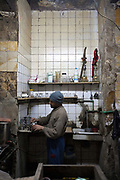 A man makes coffee in a coffeeshop 'Doctor' - allegedly nearly a century old. Islamic Cairo, Egypt