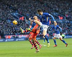 Leicester City's David Nugent put the ball across Bolton Wanderers' Alex John-Baptiste - Photo mandatory by-line: Nigel Pitts-Drake/JMP - Tel: Mobile: 07966 386802 29/12/2013 - SPORT - FOOTBALL - King Power Stadium - Leicester - Leicester City v Bolton Wanderers - Sky Bet Championship