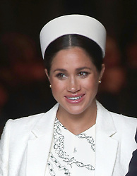 The Duchess of Sussex leaves following a Commonwealth Service at Westminster Abbey, London.