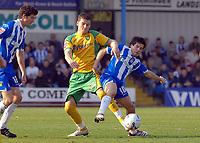 Photo: Ashley Pickering.<br />Colchester United v Norwich City. Coca Cola Championship. 31/03/2007.<br />Chris Martin of Norwich (L) tackles Kem Izzet of Colchester
