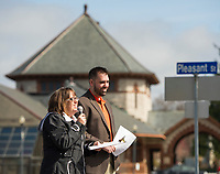 Karmen Gifford and Jay Bolduc from the Lakes Region Chamber of Commerce welcome city officials, Laconia elementary students and guests to the official kickoff event for the 2017 Pumpkin Fest on Thursday morning.   (Karen Bobotas/for the Laconia Daily Sun)