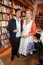 JAMES EVANS and  EMMA WOOLARD at a party to celebrate the publication of Charlotte Eagar's book'The Girl in the Film'held at the Daunt Bookshop, Holland Park Avenue, London on 10th July 2008.NON EXCLUSIVE - WORLD RIGHTS