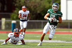 01 October 2016:  Adam Muellers grabs the incoming pass with J. Moore out of position to stop the pass or the run to the touchdown during an NCAA division 3 football game between the Wheaton Thunder and the Illinois Wesleyan Titans in Tucci Stadium on Wilder Field, Bloomington IL (Photo by Alan Look)