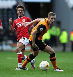 Bobby Reid of Bristol City plays a pass under pressure from Michael Dawson of Hull City - Mandatory by-line: Dougie Allward/JMP - 02/04/2016 - FOOTBALL - KC Stadium - Hull, England - Hull City v Bristol City - Sky Bet Championship