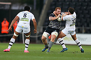 Dan Baker of the Ospreys © is tackled around his neck by Remi Lamerat of Clermont Auvergne (r). . European Rugby Champions Cup, pool 2 match, Ospreys v ASM Clermont Auvergne at the Liberty Stadium in Swansea, South Wales on Sunday 15th October 2017.<br /> pic by  Andrew Orchard, Andrew Orchard sports photography.