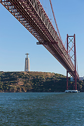 April 25th Bridge across River Tagus and Cristo Rei Statue, Lisbon,  Portugal