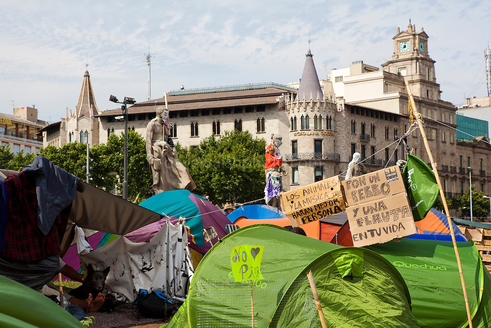 """Protest camp at Placa de Catalunya, Barcelona, Spain. The signs read: """"Animals and music will make you a better person; put a dog and a flute in your life"""". The square has been relatively quiet since police attacked and beat protestors on May 27 2011."""