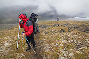 Parmenter and Liana Welty hike through stormy weather on a backpacking trip in the Skolai Pass area of Wrangell-St. Elias National Park, Alaska.