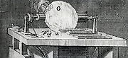 Static electric machine (possibly Hauksbee's) using  glass globe to generate a charge by friction, 1747.