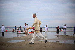 © Licensed to London News Pictures. 18/09/2016. Portsmouth, UK. A batsman running between the wickets. Teams take part in the  Bramble Bank Cricket Match in the middle of The Solent strait on September 18, 2016. The annual cricket match between the Royal Southern Yacht Club and The Island Sailing Club, takes place on a sandbank which appears for 30 minutes at lowest tide. The game lasts until the tide returns. Photo credit: Ben Cawthra/LNP