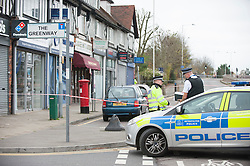 © Licensed to London News Pictures. 10/11/2015. London, UK. Police cordon off the area around the parade of shops near West Ruislip tube station after a man was fatally stabbed during Monday evening's rush hour.  Eyewitness reports indicate that the man died from a knife wounds received from a resident who lived above a nearby Tesco Express.  The stabbing took place by a post box outside security shop nearby (pictured). Photo credit : Stephen Chung/LNP