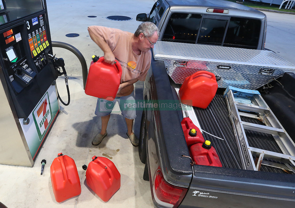 Jeff Beebe, of Cape Canaveral, FL, USA, fills gasoline containers early Wednesday morning, Oct. 5, 2016, which would be available later used for his generator. Beebe is evacuating his home along with his 80-year-old parents to Orlando. Photo by Red Huber/ Orlando Sentinel/TNS/ABACAPRESS.COM