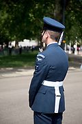 Member of the RAF Regiment stands guard. Royal procession for the State Opening of Parliament, London.