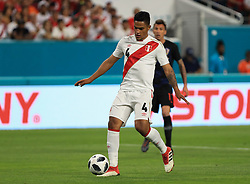 March 23, 2018 - Miami Gardens, Florida, USA - Peru midfielder Anderson Santamaria (4) controls the ball during a FIFA World Cup 2018 preparation match between the Peru National Soccer Team and the Croatia National Soccer Team at the Hard Rock Stadium in Miami Gardens, Florida. (Credit Image: © Mario Houben via ZUMA Wire)