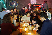 """Guests enjoying food, drink and ambience. <br /><br />The Freegan Pony is an alternative restaurant housed in a squat. It was founded in 2015 by Aladdin Charni with three other collaborators. The restaurant specialises in cheap vegetarian cuisine, serving meals which guests reserve a place through a Facebook group, paying €2 a meal. The restaurant meals contain unsold and donated food, collected from wholesellers at the Paris Rungis vegetable market. The Freegan Pony is located at the Porte de la Vilette on the outskirts of Paris, at the entrance to the peripherique outer circle motorway.<br /><br />Freegans are people who employ alternative strategies for living based on limited participation in the conventional economy and minimal consumption of resources. Freeganism is the practice of reclaiming and eating food that has been discarded. People who attempt to live an ethical lifestyle by reusing trash and rubbish thrown away by others.<br /><br />Freeganism is an ill-defined activity and is a subset of the larger anti-capitalist and environmental protest movements. It embraces alternative, anti-consumerist lifestyles. Freegan practices also include co-operative living, squatting and """"freecyling"""", or matching things that people want to get rid of with things other people need"""