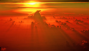 Sunset viewed from above the clouds.