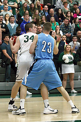 21 February 2015:  Ryan Coyle tries to back in against Brandon Schwebke during an NCAA men's division 3 CCIW basketball game between the Elmhurst Bluejays and the Illinois Wesleyan Titans in Shirk Center, Bloomington IL