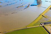 Nederland, Gelderland, Brummen, 20-01-2011; Cortenoever, IJssel bij hoogwater. De rivier staat tegen de Brummense Bandijk, de uiterwaarden staan onder water. Het zomerbed en de vaargeul zijn te herkennen aan de bakens..High water in the river IJssel, flood-wal or winter dike protecting the land against it. Fairway is marked by the flooded trees..luchtfoto (toeslag), aerial photo (additional fee required).copyright foto/photo Siebe Swart