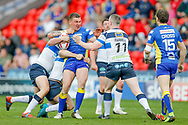 Doncaster RLFC interchange Russ Spiers (8) is tackled  during the Challenge Cup 2018 match between Doncaster and Featherstone Rovers at the Keepmoat Stadium, Doncaster, England on 22 April 2018. Picture by Simon Davies.