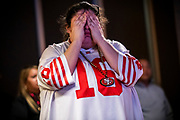 SAN FRANCISCO, CA - FEBRUARY 02: A San Francisco 49ers fan reacts during a Super Bowl LIV watch party after the Kansas City Chiefs defeat the San Francisco 49ers, at SPIN San Francisco on February 2, 2020 in San Francisco, California. The San Francisco 49ers faced the Kansas City Chiefs in Super Bowl LIV for their seventh appearance at the NFL championship, leading the game into half time and losing after 21 unanswered points in the second half of the game. (Photo by Philip Pacheco/Getty Images)