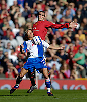 Photo: Jed Wee.<br />Manchester United v Blackburn Rovers. The Barclays Premiership. 24/09/2005.<br /><br />Blackburn's Morten Gamst Pedersen (L) chests the ball down under pressure from Manchester United's John O'Shea.
