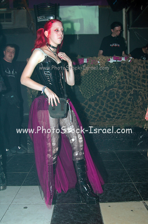 a young teen with torn stockings Dancing at a nightclub