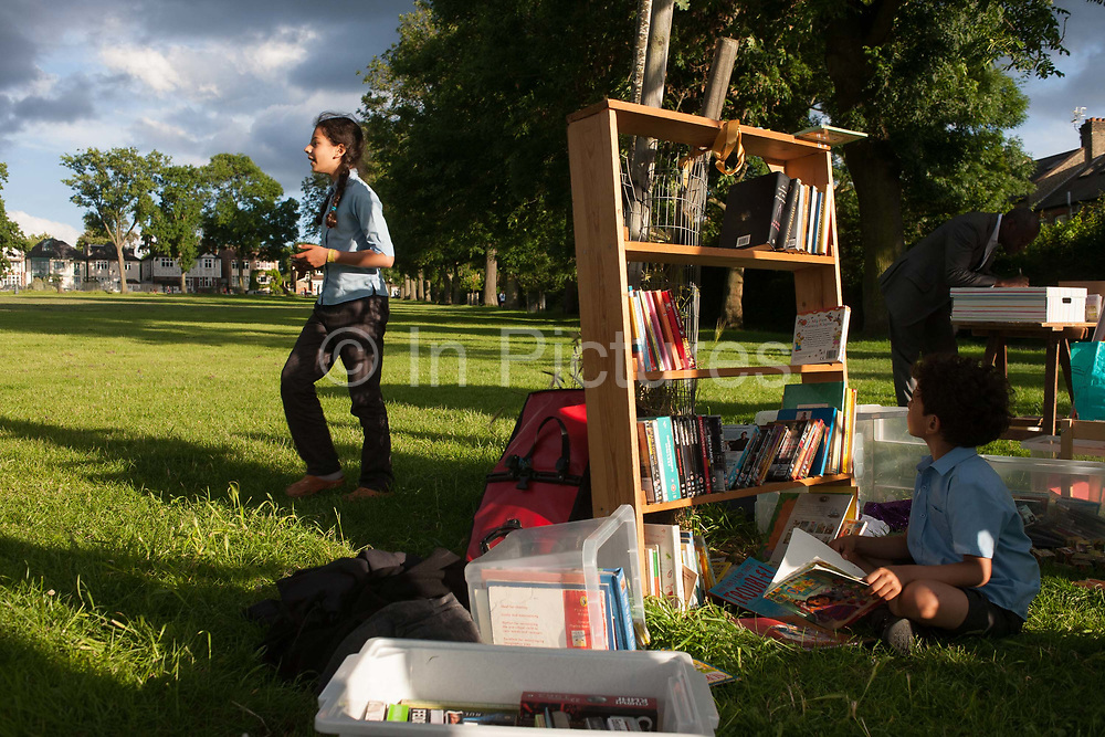 Members of the campaign to save nearby Carnegie Library in Herne Hill and closed by Lambeth council, organise a pop-up library and party in Ruskin Park, SE24 on 21st June 2016, in south London, United Kingdom. Shut since 31st March, children, the elderly and other adult groups have been prevented from using the building uphill from this location as Lambeth decide how to use the public space, bequeathed to the community by philanthropist, Andrew carnegie in 1911.