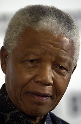 """Former South African President Nelson Mandela at the """"Ethnic Multicultural Media Awards """" (EMMA) where he received a 'Lifetime Achievement Award' at The South Africa High Commission, London.  *  17/9/2000:  Mandela will kick-start Labour's election campaign taking central stage at the party's conference.  The former South African president, will endorse Prime Minister Tony Blair on the final day of the Blackpool gathering.  1/11/02: South African President Nelson Mandela who is visiting Princess Diana's grave at her ancestral home in Althorp, Friday 1 November 2002. He will plant a tree in the grounds of the Northamptonshire estate and lay a wreath at the island burial site, as part of a visit to discuss a new charity project with the Princess's brother Earl Spencer."""