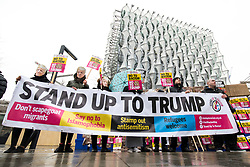 © Licensed to London News Pictures. 20/01/2018. London, UK. Anti-racism activists protest against US President Donald Trump outside the new American Embassy in Nine Elms on the first anniversary of his inauguration. Trump has cancelled his planned February 2018 visit to the UK and has described the new embassy as a 'bad deal'. Photo credit: Rob Pinney/LNP