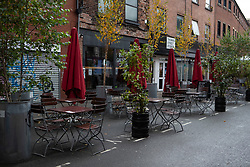 © Licensed to London News Pictures. 20/10/2020. Manchester, UK. A bar in Northern Quarter, Manchester sits quiet. Manchester is expecting to be forced in to a Tier 3 lockdown unless a deal is agreed, which could see businesses such as pubs and bars closed. Photo credit: Kerry Elsworth/LNP